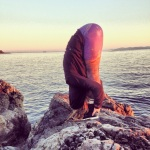 Uttanasana on the Juan de Fuca Straight, Victoria BC. yoga forward fold