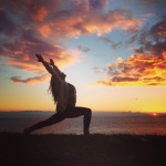 Crescent lunge over looking the Juan de Fuca Straight, Victoria, BC. Yoga sunset