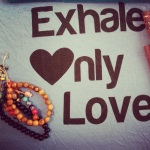 Exhale only love tank top from wanderlust yoga festival and mala bracelets