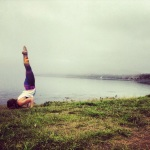 Yoga chin stand at Clover Point in the fog, Victoria BC wearing Teeki pants