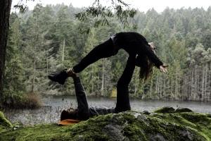 Acro yoga or partner yoga, high flying whale stretch at Killarney Lake, Victoria BC