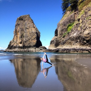Side plank variation on Second Beach in La Push, Washington.