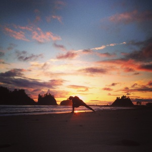 Bound side angle pose during an amazing sunset on the beach in La Push.