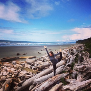 Dancers pose of some driftwood on our pit stop at the beach on our way to La Push.