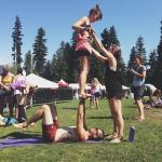 Friends Helping Friends with some Acro Yoga at Wanderlust Whistler 2014
